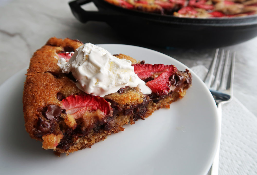 A slice of Strawberry Chocolate Chip Skillet Cookie on a plate.