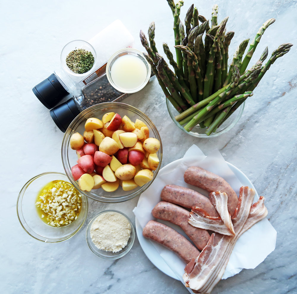 Sausages, potatoes, asparagus, parmesan, garlic, and olive oil.