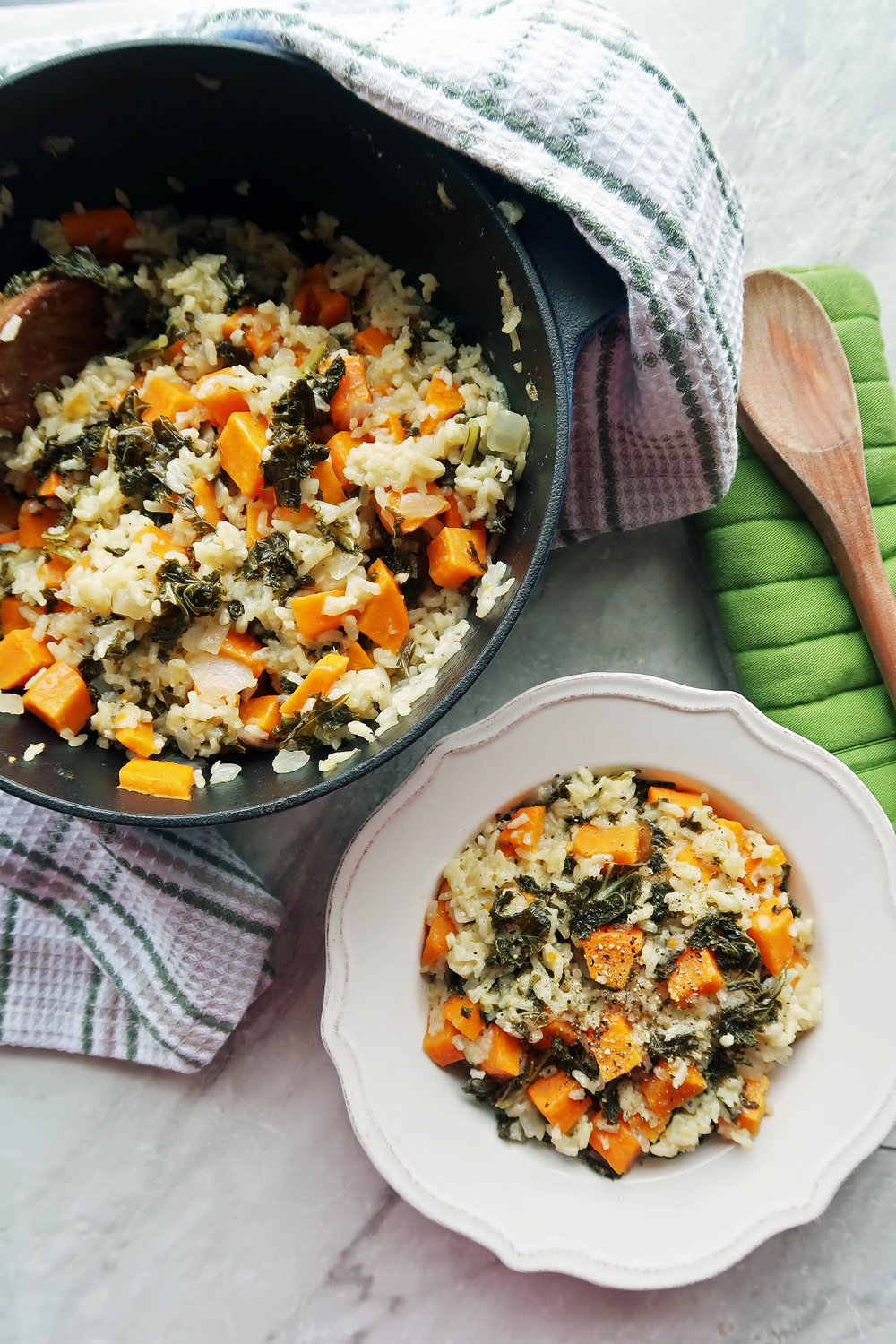 Oven-Baked Risotto with Sweet Potato and Kale on a white plate and in a Dutch oven.