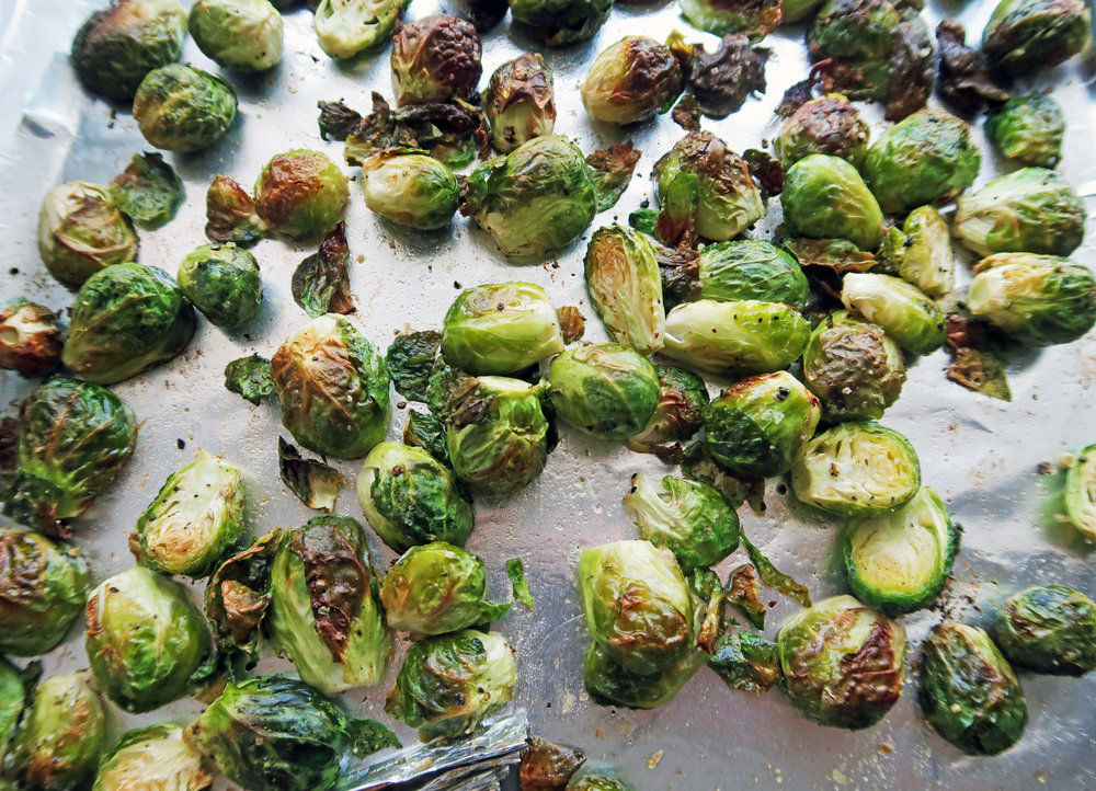 Crispy Roasted Brussels Sprouts on a baking sheet.