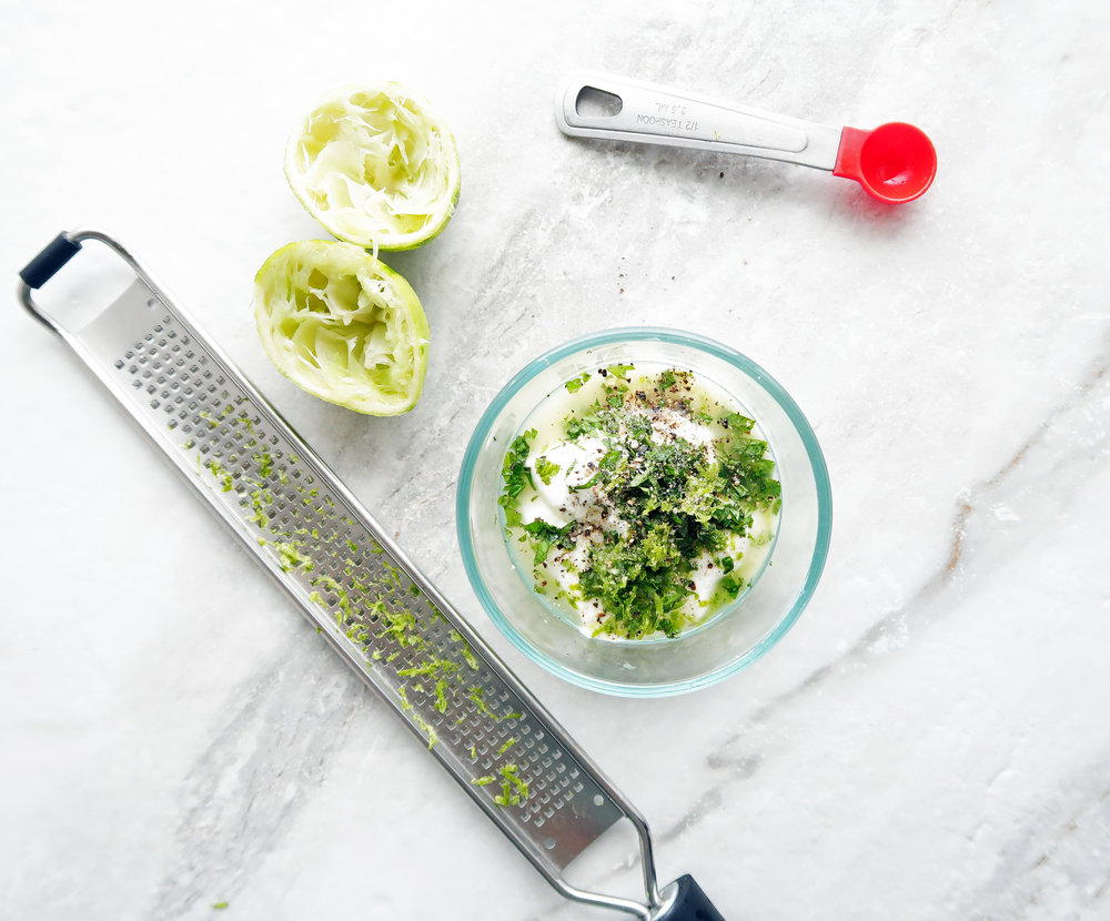Lime-mint yogurt dressing ingredients in a bowl.