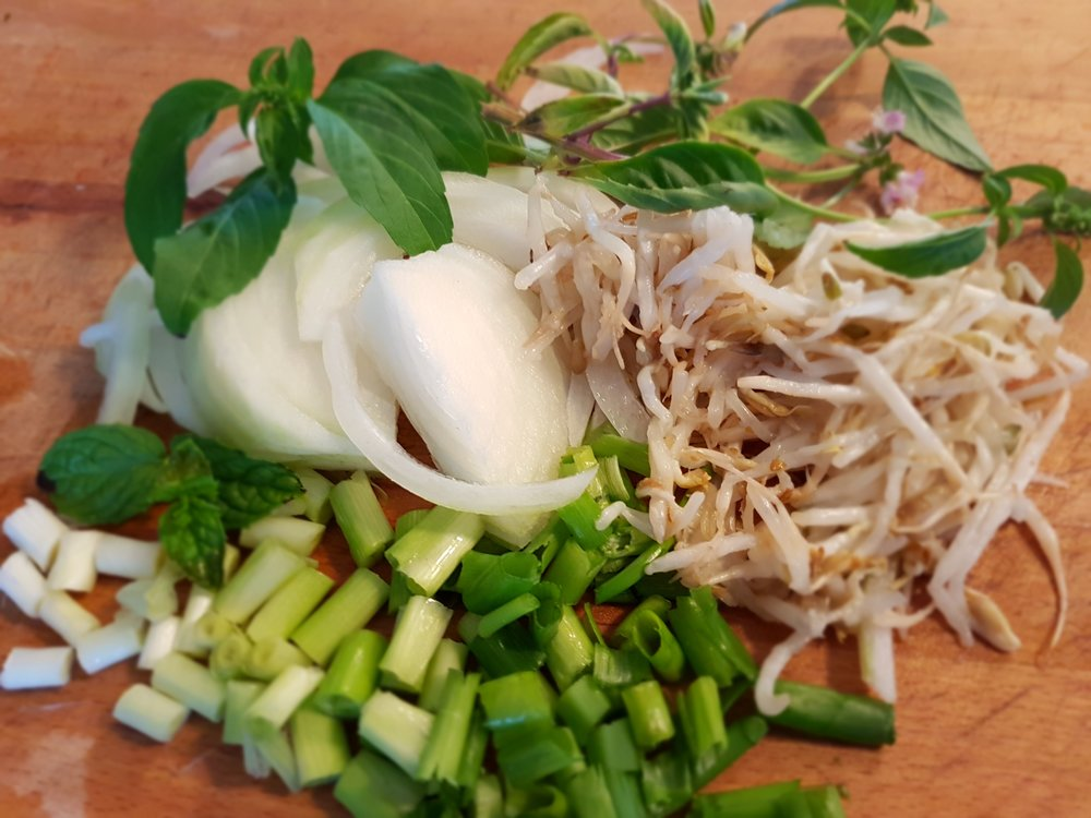 onions, bean sprouts, and Thai basil ready for the broth