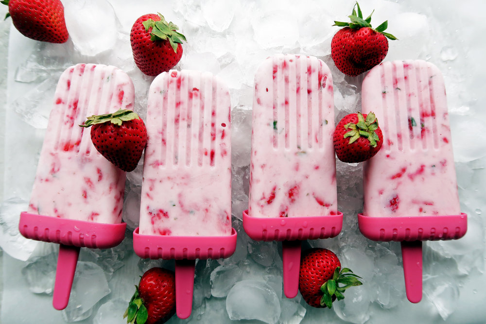 Fresh Strawberry Mint Yogurt Popsicles: A low-fat, no-bake, gluten-free cold dessert that's easy to prepare with only 4 ingredients. www.yayforfood.com