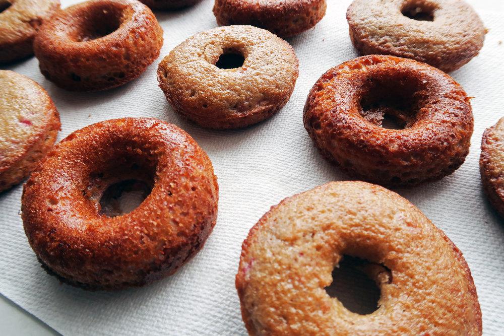Freshly baked golden brown donuts.