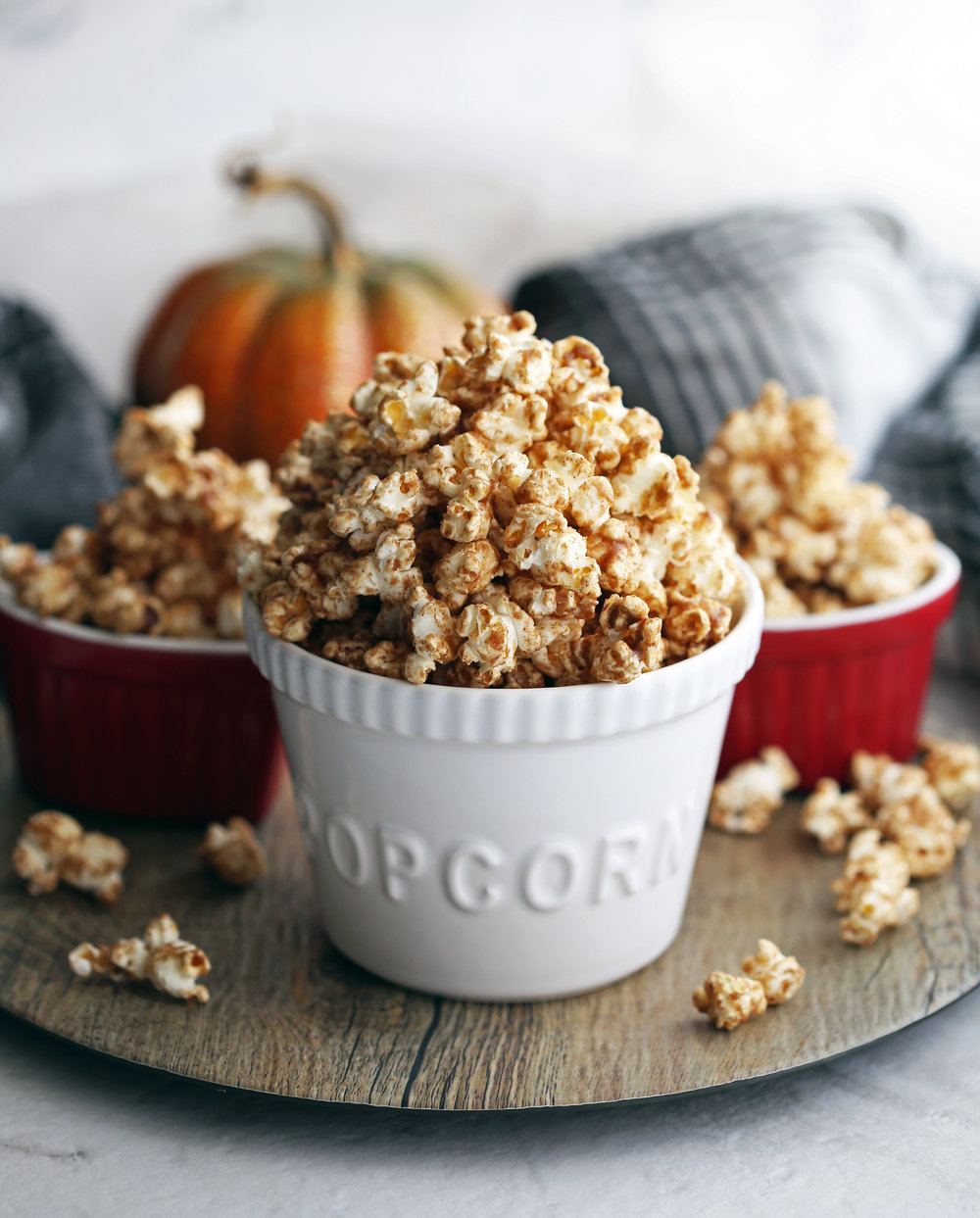 Three bowls filled with homemade pumpkin spice butterscotch popcorn.