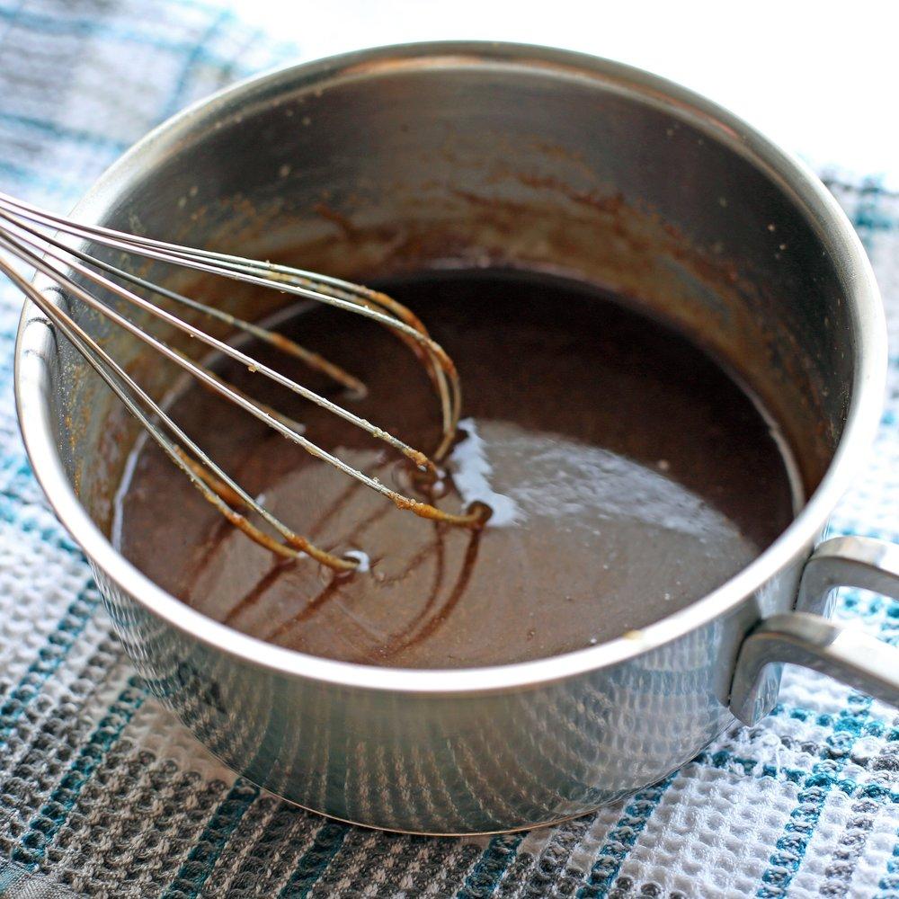 Homemade butterscotch sauce in a small saucepan.