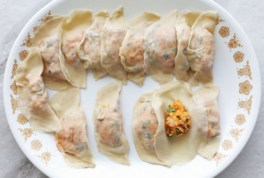 Dumpling wrappers filled sweet potato cream cheese filling.