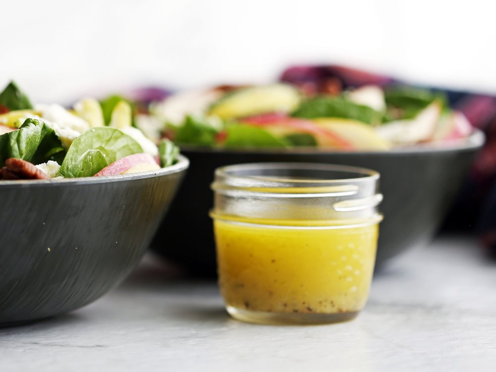 Honey lemon ginger vinaigrette in a small mason jar.