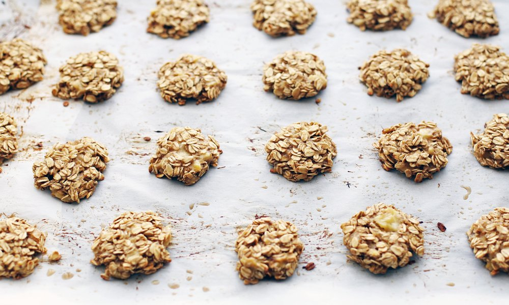 Oatmeal banana cookies on a baking sheet.