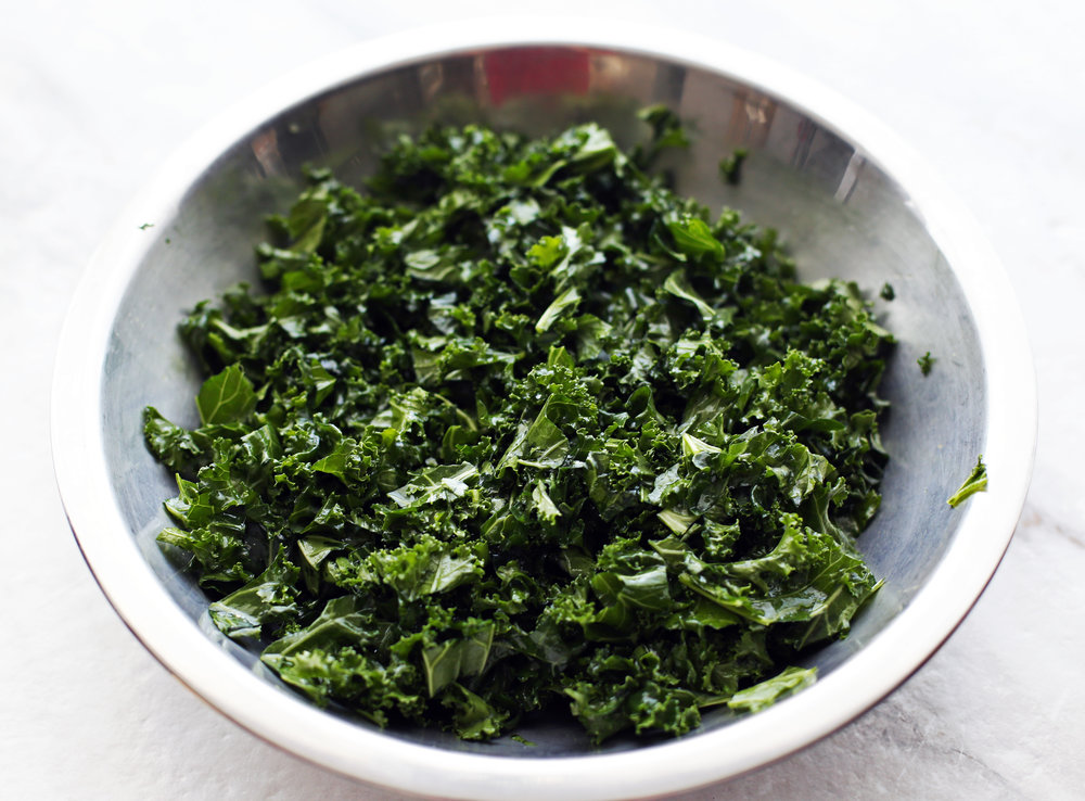 Finely chopped kale tossed with olive oil and salt.