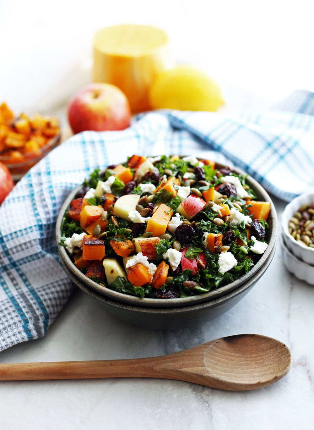 Kale salad with roasted butternut squash, apple, goat cheese, pumpkin seeds, and dried cherries.