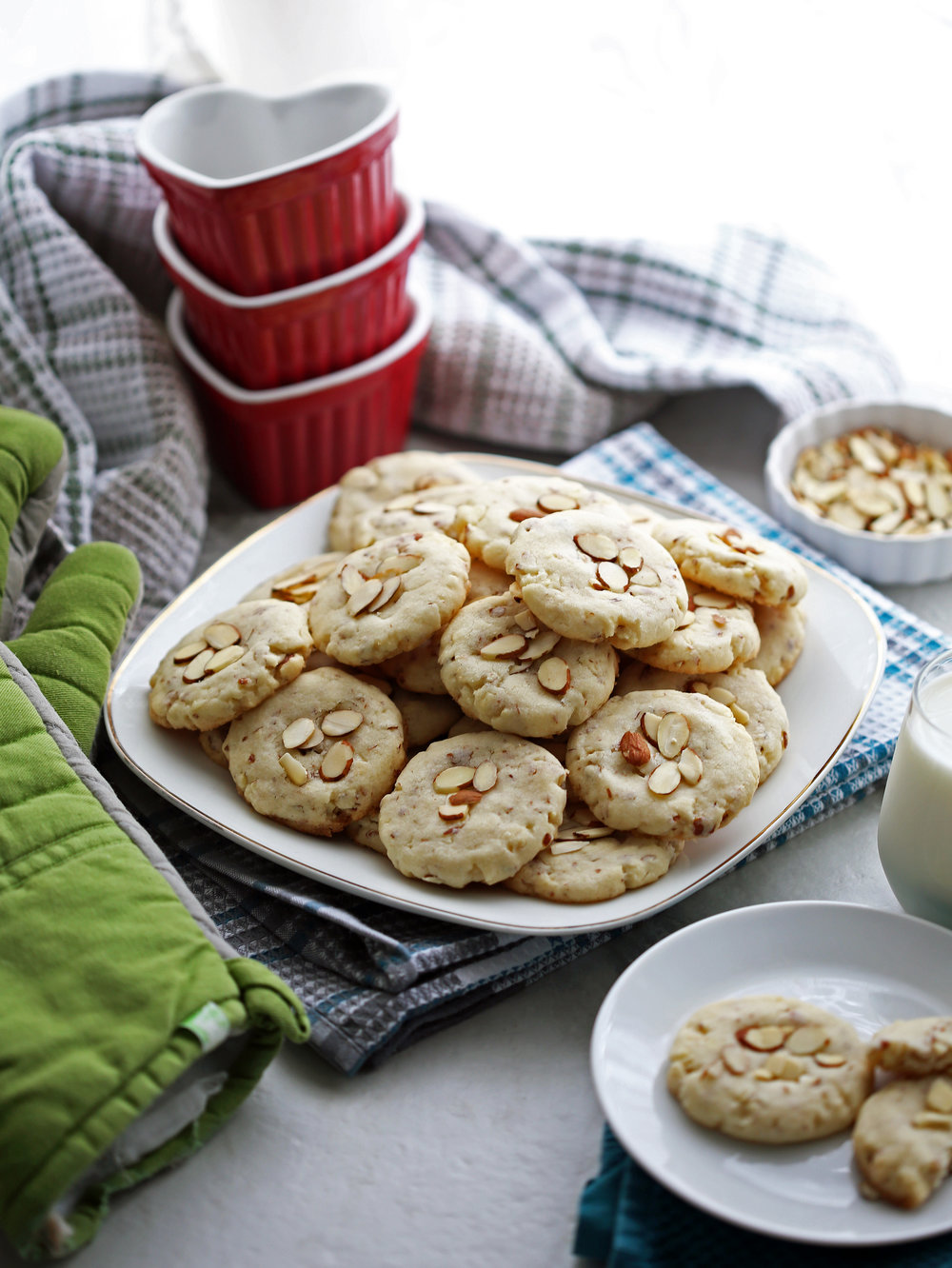 Crunchy almond cookies on a white plate.