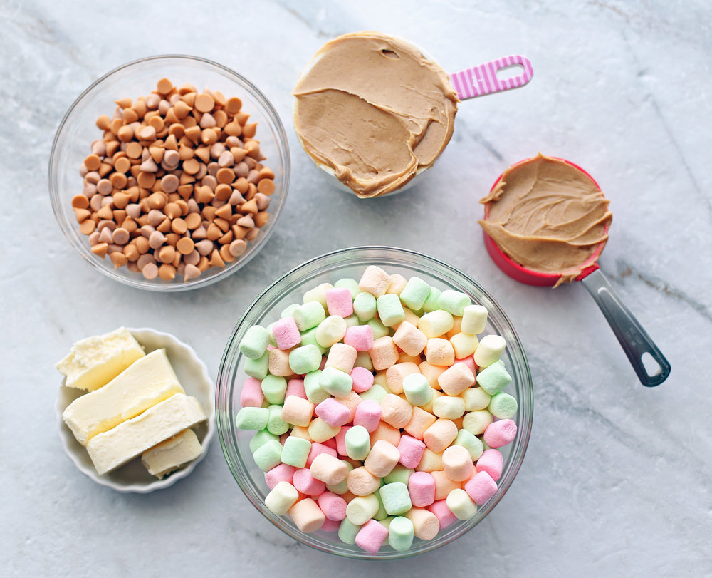 Overhead shot of colourful marshmallows, butter, peanut butter, and butterscotch chips.