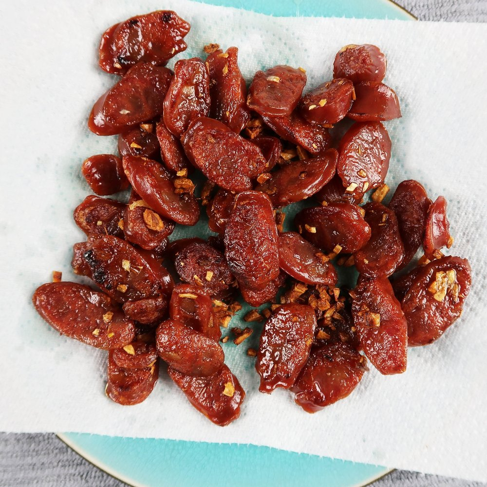 Crispy fried Chinese sausage (lap cheong) with garlic.