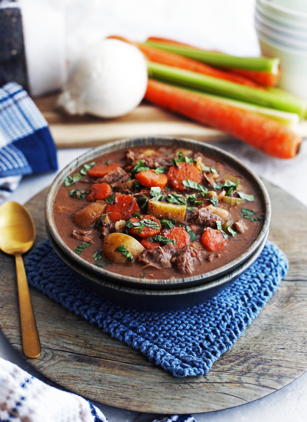 A bowl of Chinese Five-Spice Beef and Vegetable Stew, which includes carrots, potatoes, and celery.