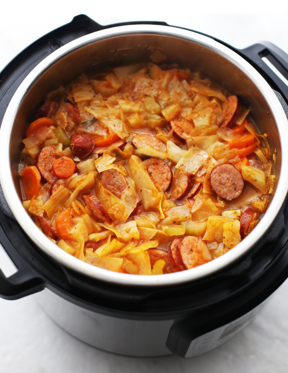 Hearty fennel, cabbage, and sausage soup in an Instant Pot.