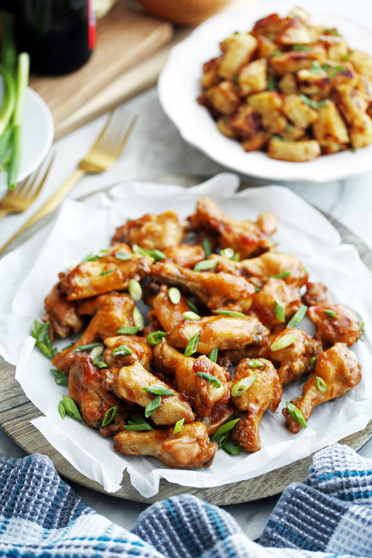 Instant pot orange teriyaki chicken wings yay for food a large wooden platter full of instant pot orange teriyaki chicken wings with green onions on forumfinder Gallery