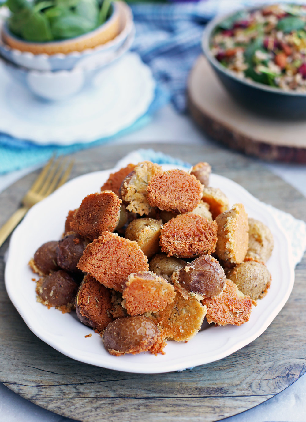 Easy, delicious Crispy Parmesan Crusted Baby Potatoes on a white plate.