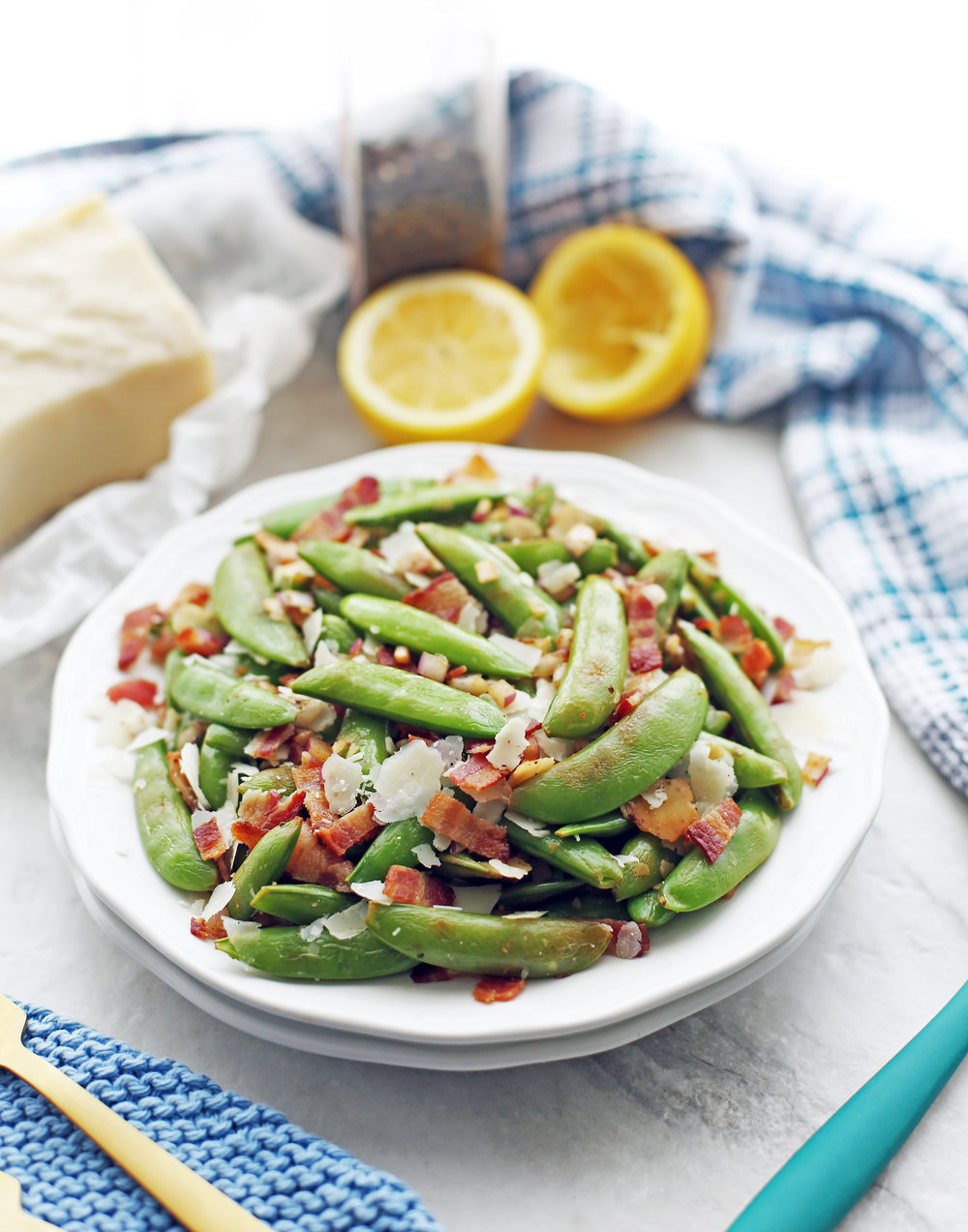 A heaping plate of sugar snap peas with bacon and parmesan.