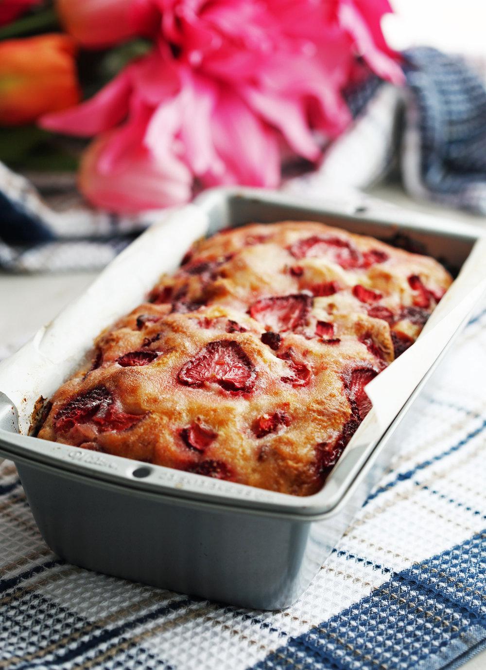 Freshly baked Strawberry Lemon Yogurt Quick Bread in a metal loaf pan.