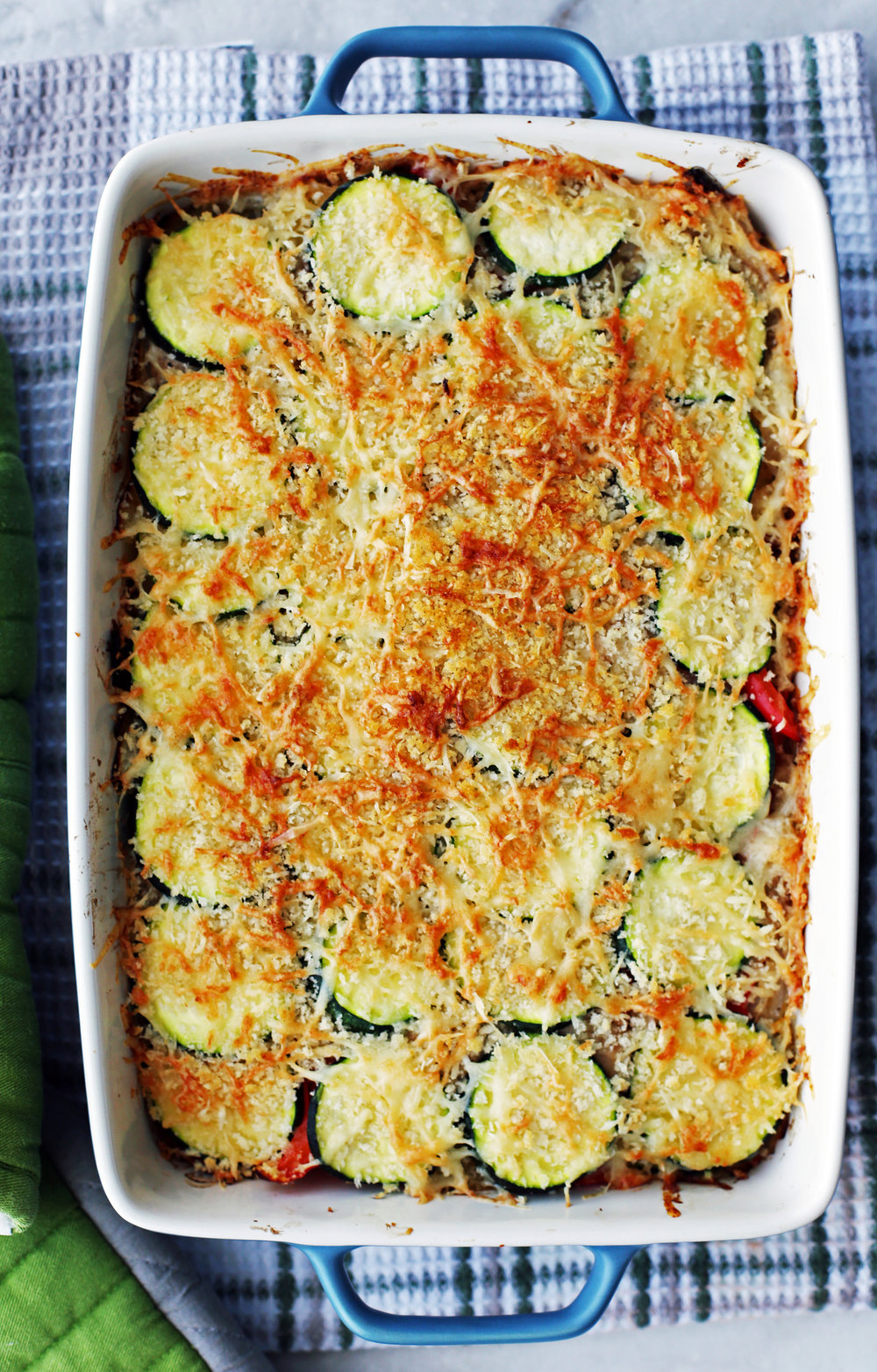 Baked Zucchini Gratin with Gruyère and Panko Breadcrumbs in a large rectangular casserole dish.