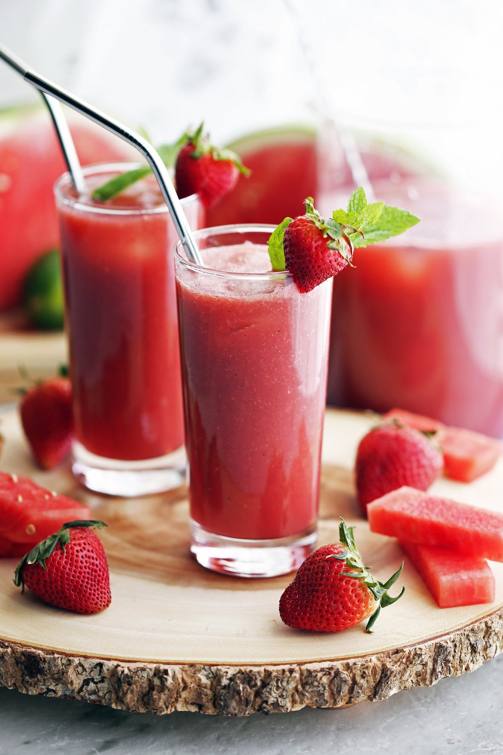 Fresh Watermelon Strawberry Soda in two tall glasses with strawberry and mint garnish.