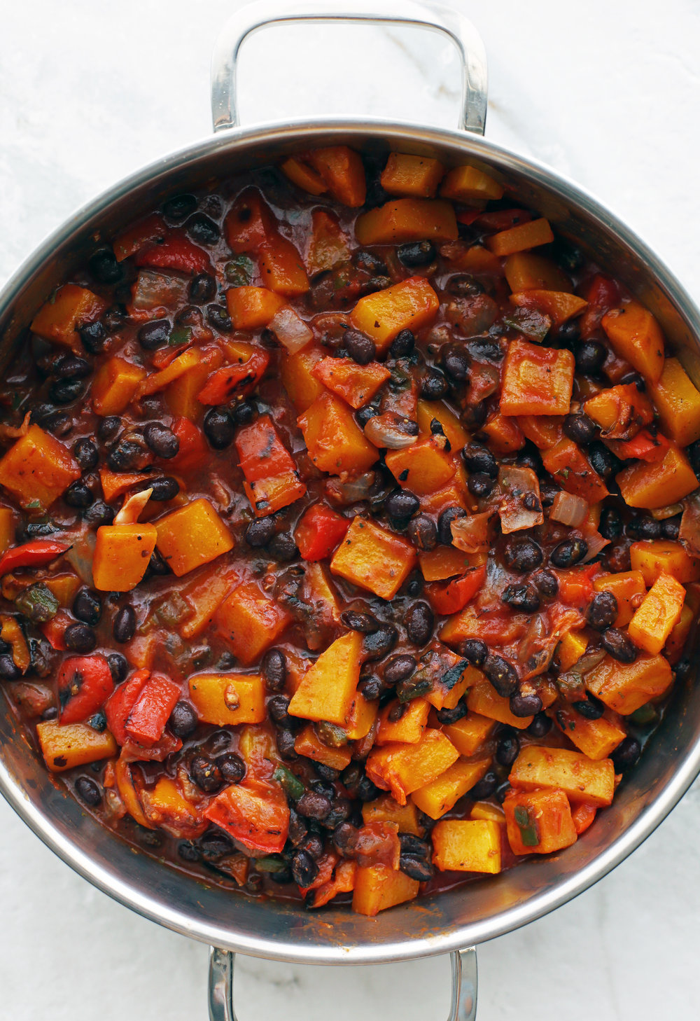 Roasted Butternut Squash and Black Bean Chili in a large metal pot.