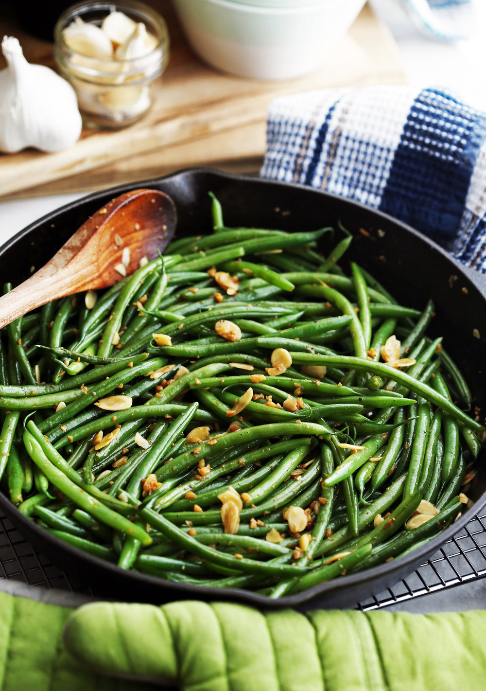 Garlic ginger green beans with almonds in an large cast iron skillet.