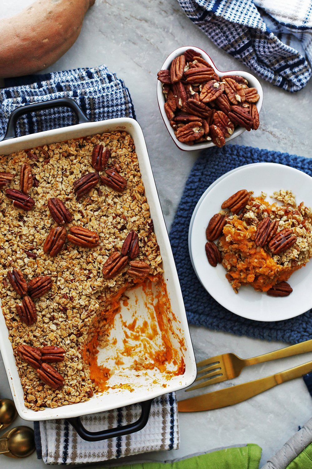 Sweet Potato Mash with Pecan Oat Topping in casserole dish and on a plate.