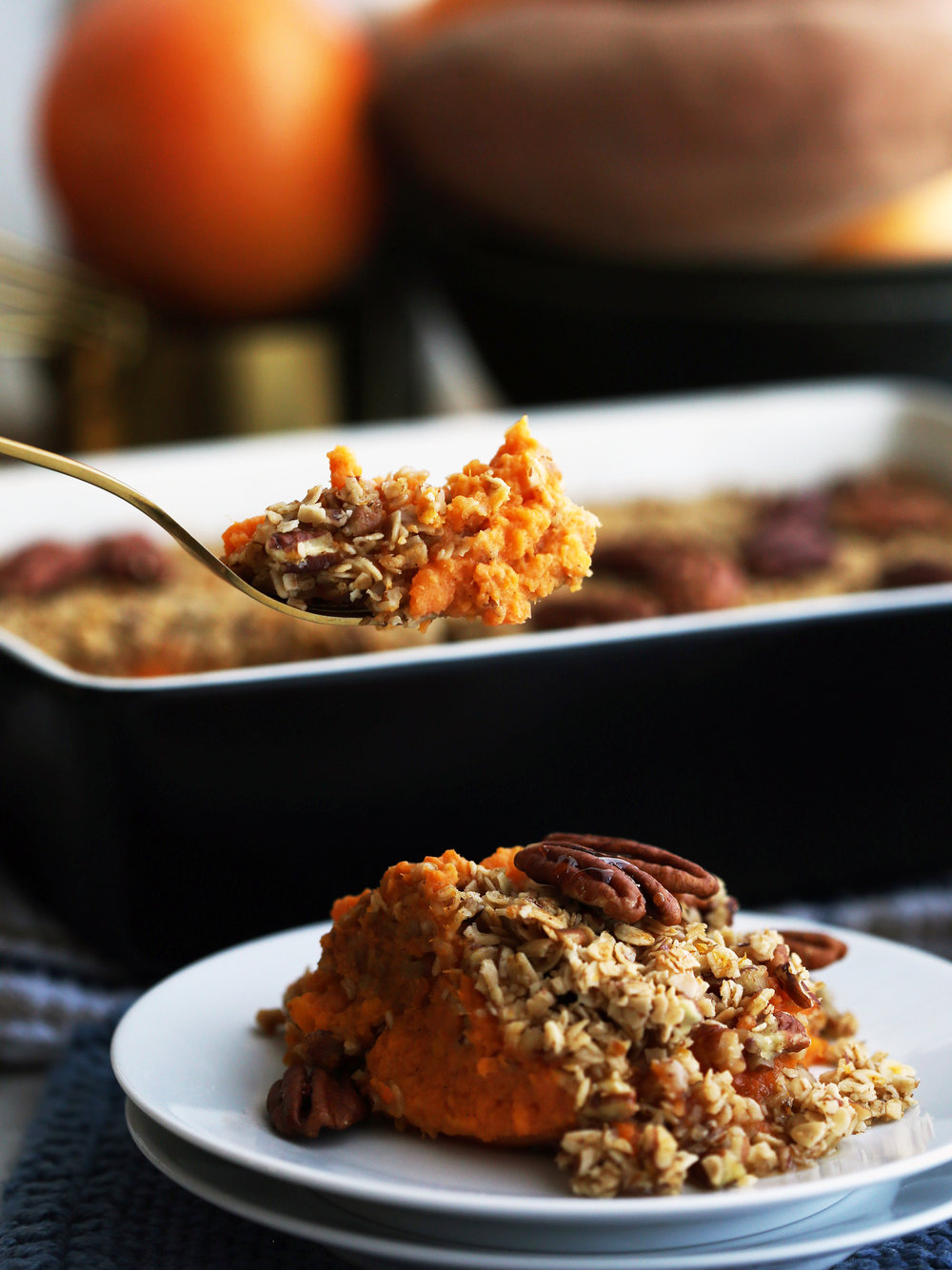 Sweet Potato Mash with Pecan Oat Topping on a fork and on a white plate.