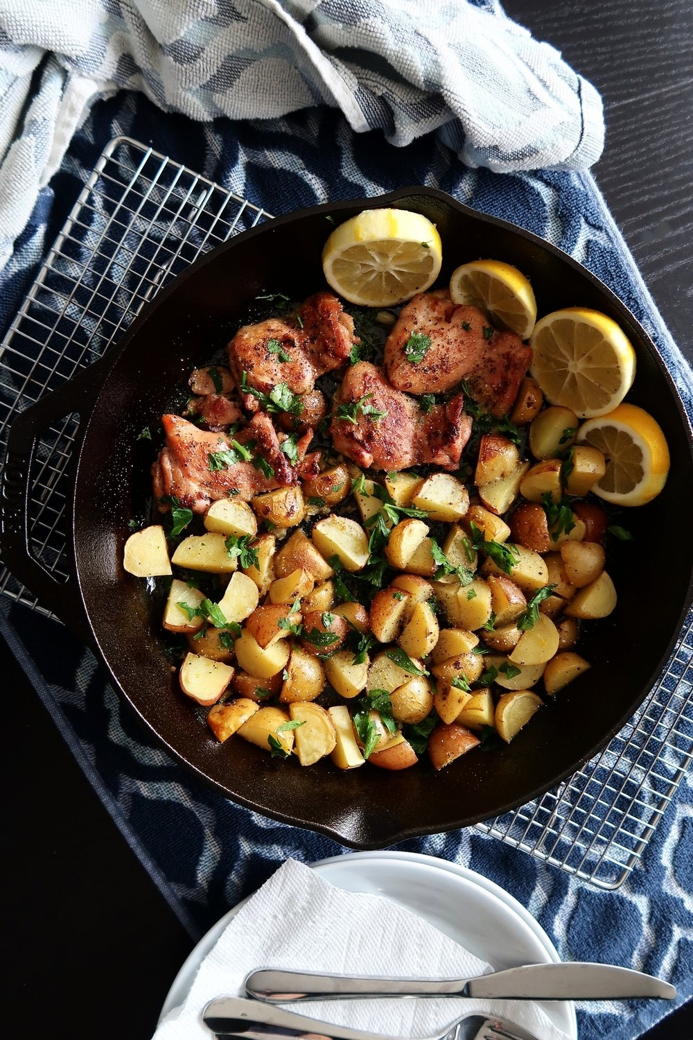 Lemon Garlic Chicken with Baby Potatoes in a cast iron skillet.