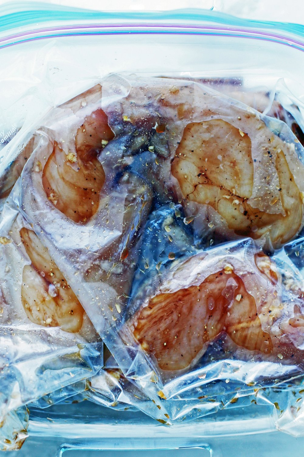 Four chicken breasts and balsamic marinade a large Ziploc (resealable) bag.