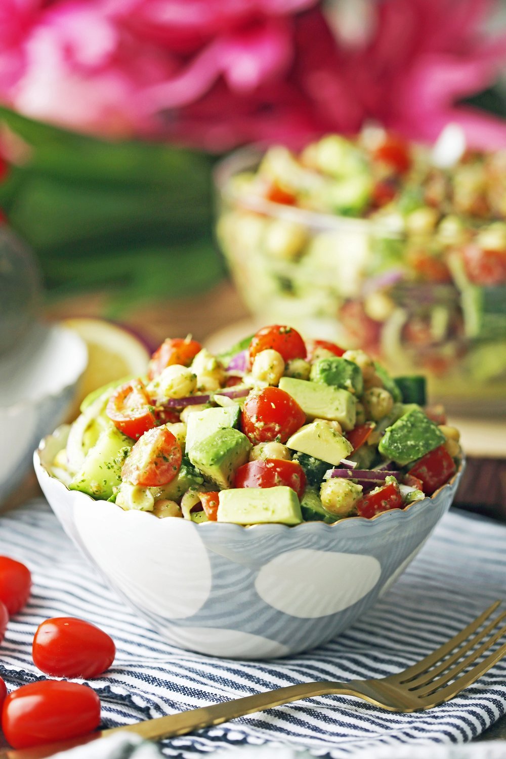 Chickpea Cucumber Avocado Salad with Parsley Dressing in a blue and white bowl with fork on the side.