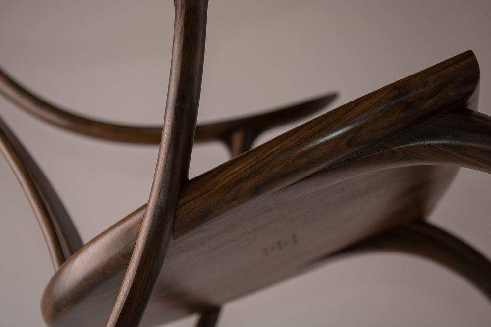 The Monogram Rocking Chair is signed and dated under the seat.