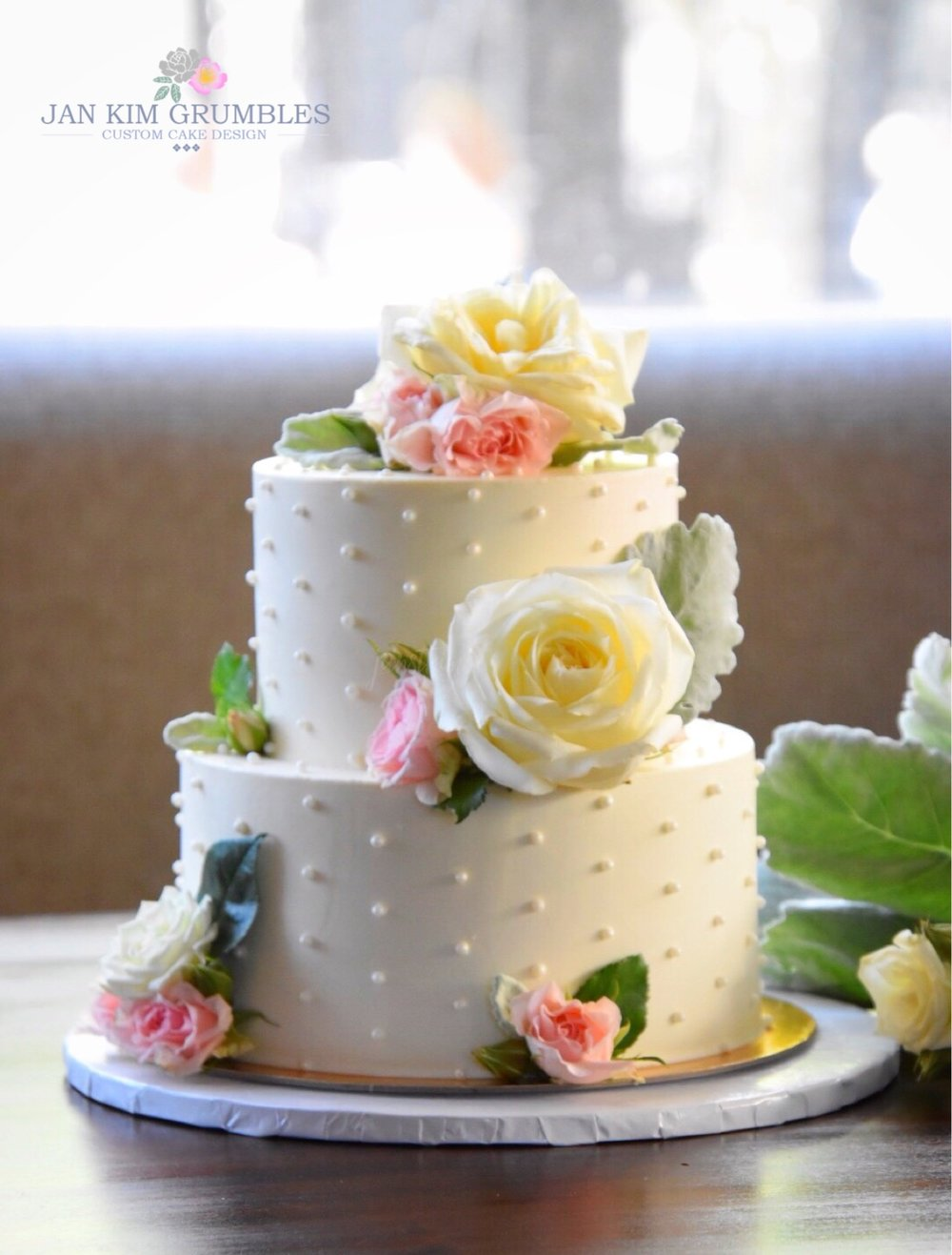 A Cute As A Button Wedding Cake Complete With Fresh Blooms Jan