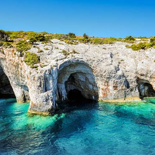 Exploring the famous green and blue caves near the island of Vis.