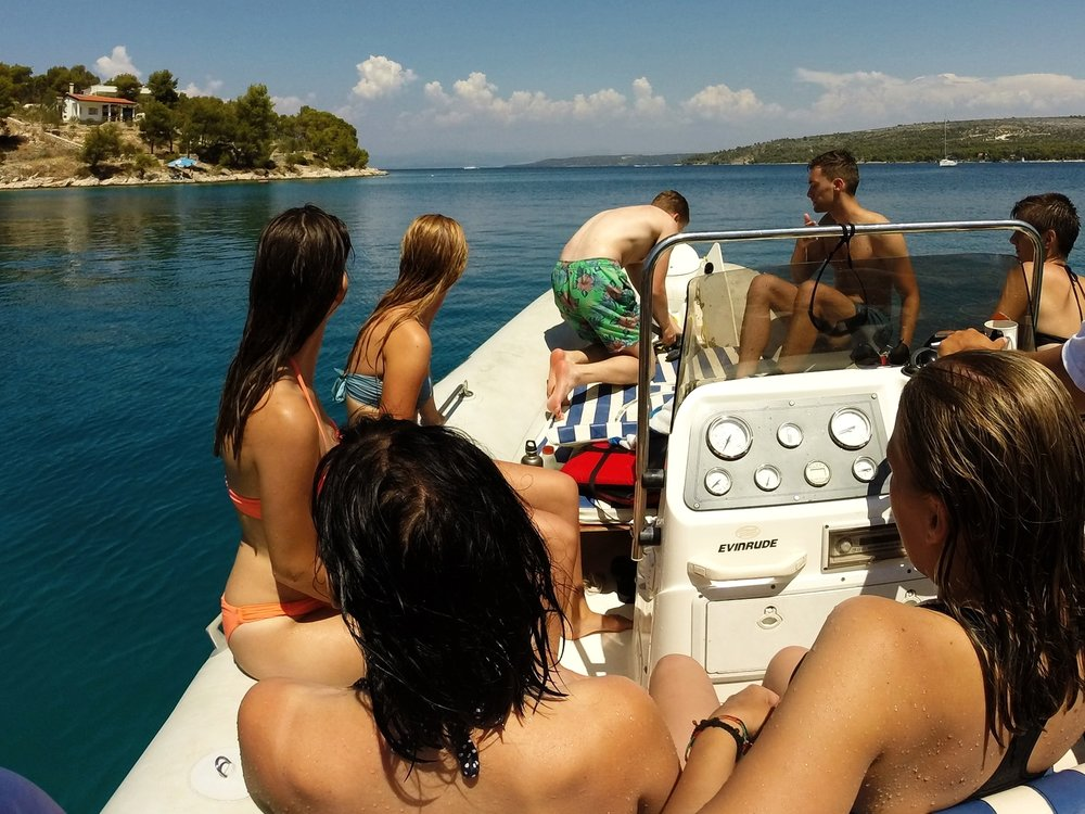 Taking up the anchor after a day of swimming and relaxing in a private bay near Milna, Brac, Croatia.