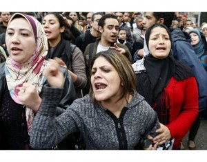 Egyptian demonstrators shout slogans as they attend a protest in Cairo