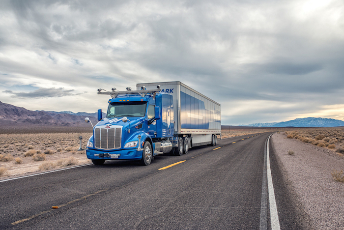 Self-driving Embark truck on the road.