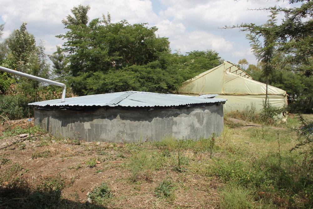 Concrete water tank at Kinda Biye