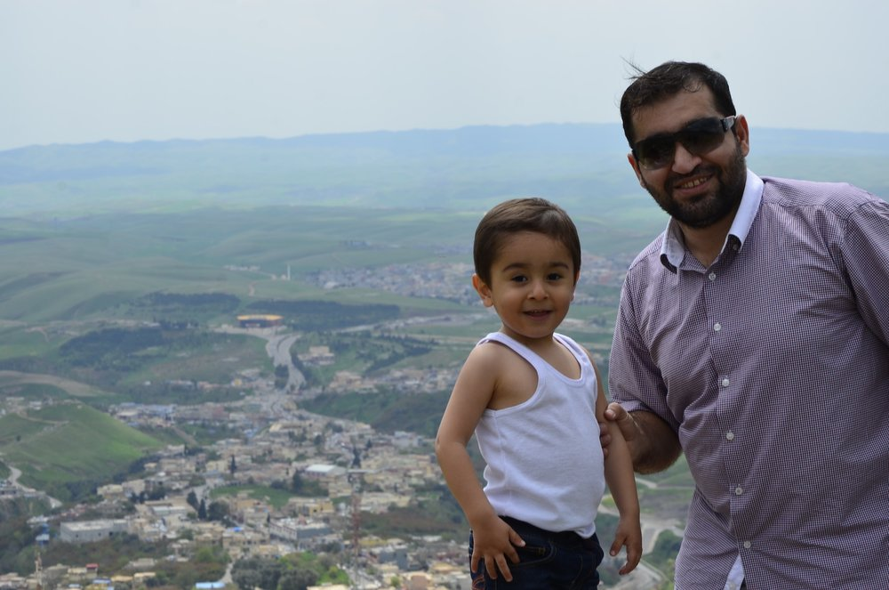 Haval and his young son, Abdullah, at Kh'ale-Akre Citadel, looking down on the beautiful city of Akre.