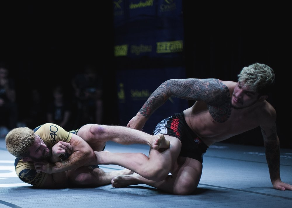 in the main event, two of the most compelling figures in no-gi BJJ, Garry Tonon of John Danaher's' New York 'Death Squad' and Conor McGregor's jiu-jitsu trainer Dillon Danis clash on British shores. This image epitomises the match, with Danis extricating himself from a leglock as Tonon wages his assault. Both this match and the co-main event featuring Dan Strauss against Jake Shields saw the Death Squad competitors apply a relentless pressure game, leaving no doubt as to the judges' decision despite no submission finish.  Photo by  Luke Jarvis  .