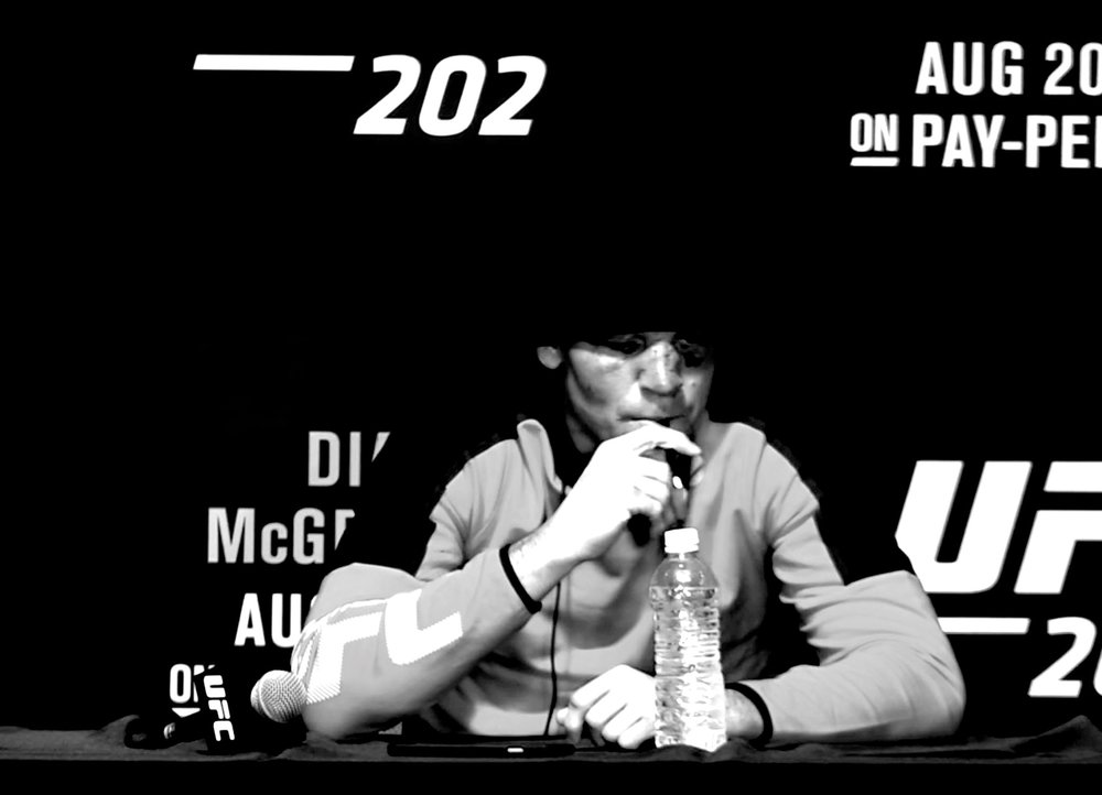 Nate Diaz vapes CBD at the UFC 202 post-fight press conference. Still from YouTube.