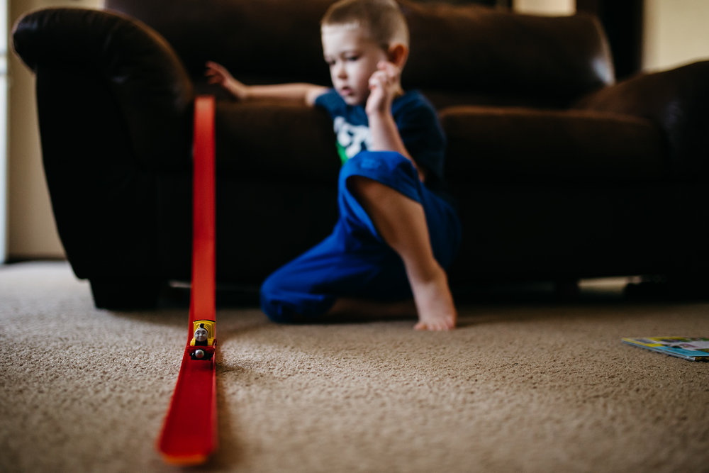 Launching trains down a homemade ramp | Rural Life Photography | Family Photojournalism