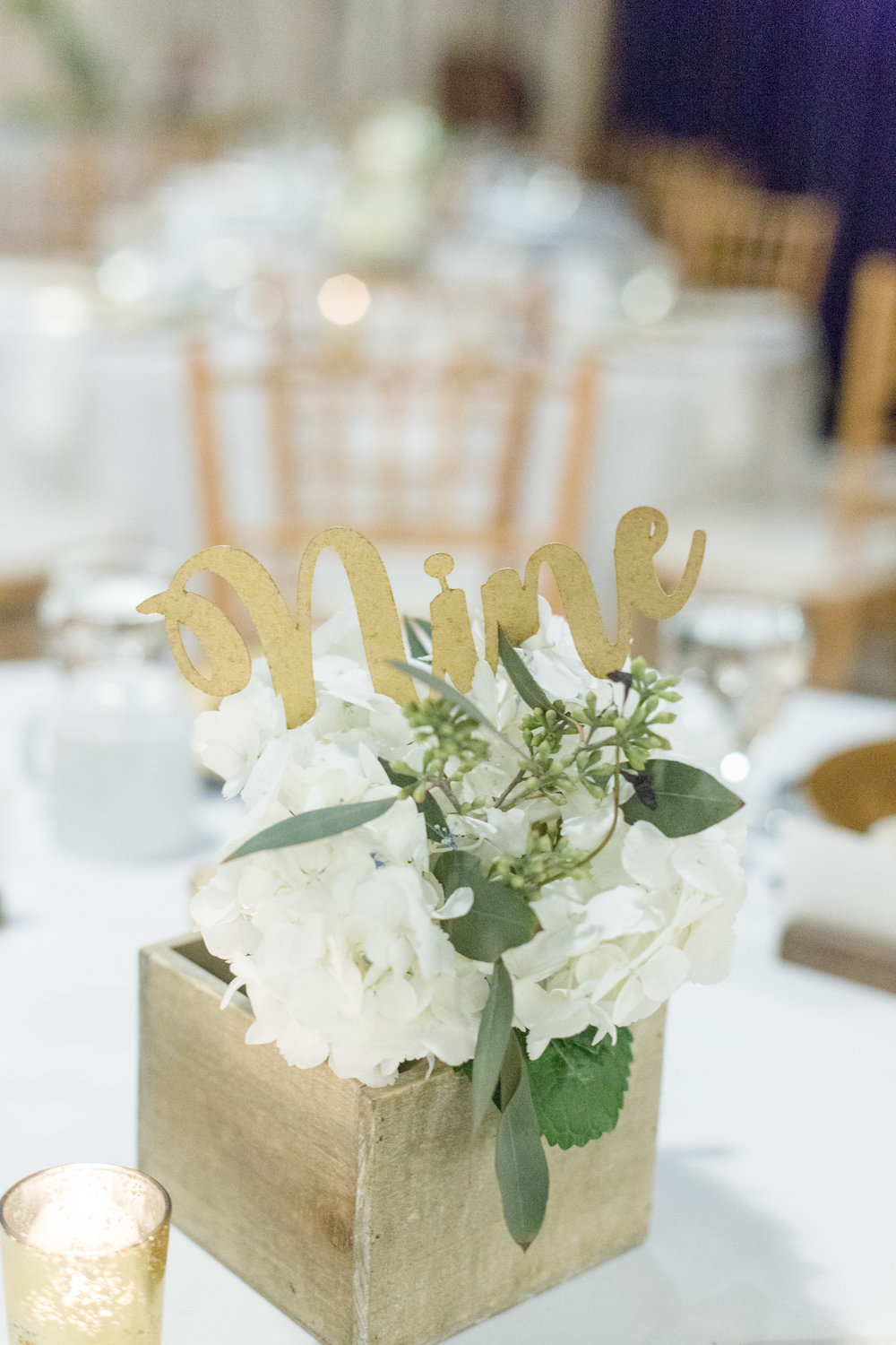 Assorted wooden flower boxes  Gold script table numbers  Photo by  Nicole Anne Photography