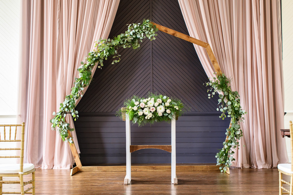 Wooden geometric arch (greenery not included)  Photo by  Brady McCloskey Photography