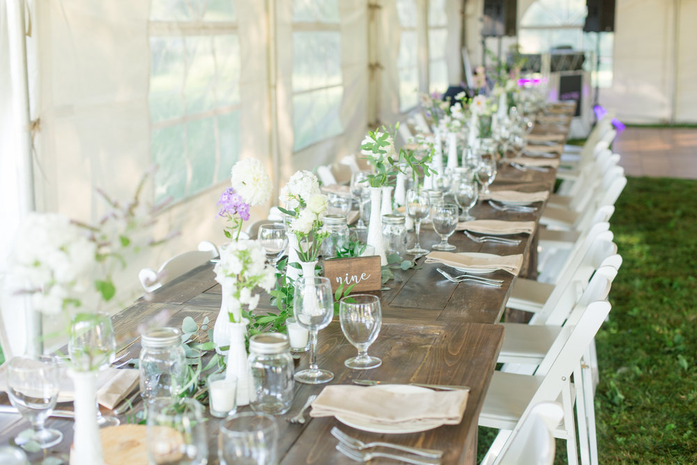 Varying size and style vintage milk glass vases  Wooden script table numbers  Photo by  Nicole Anne Photography