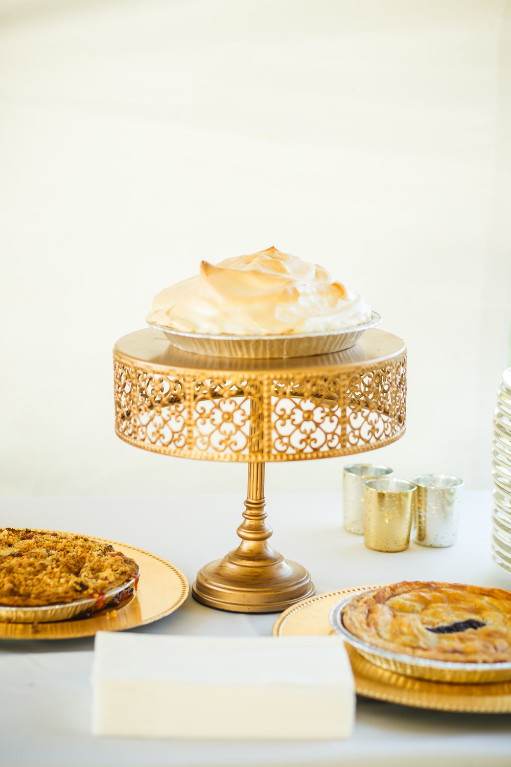 Gold intricate cake stand  Photo by  Simon Reid Photography