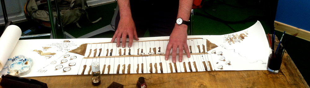 Chris Glynn creates a hand-drawn keyboard during a Coleridge talk at Hay Festival 2016