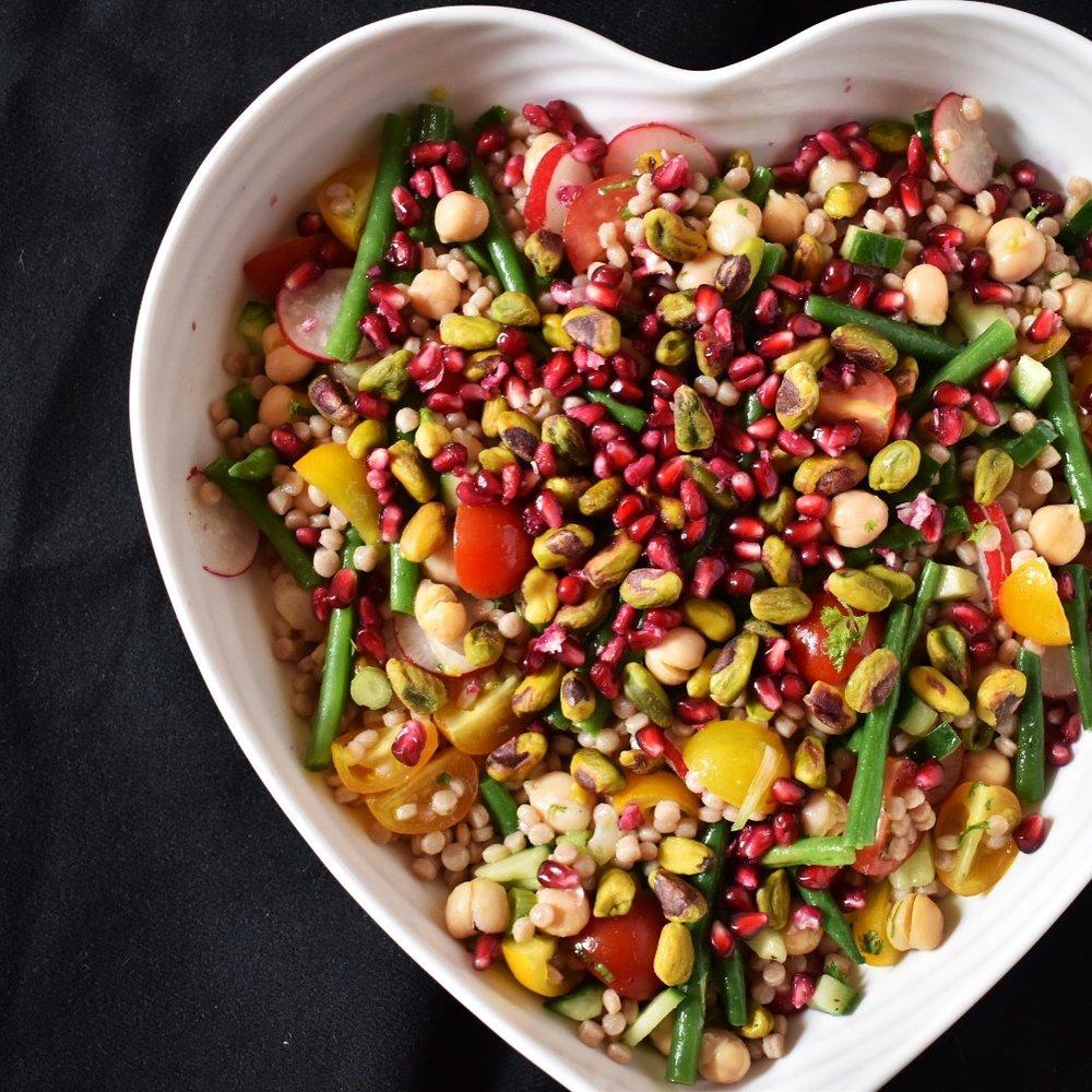 Vegan pomegranate and pistachio giant cous cous salad recipe